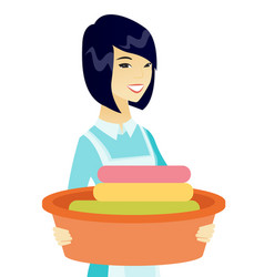 asian housewife holding basin with dirty linen vector image