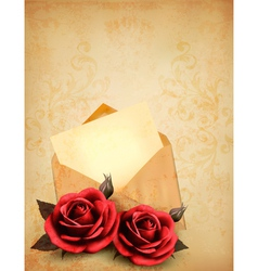 Two roses in front of an old envelope with a vector image
