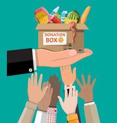 cardboard box full food in hand vector image