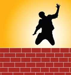 Man jump brick wall silhouette vector