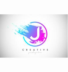 J artistic brush letter logo design in purple vector
