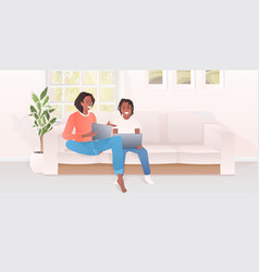 Mother with daughter using laptops african vector