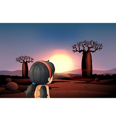 A young girl watching the sunset at the desert vector image vector image