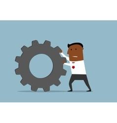 Unhappy businessman pushing a gear wheel vector
