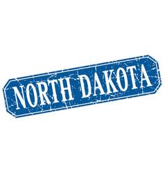 North dakota blue square grunge retro style sign vector