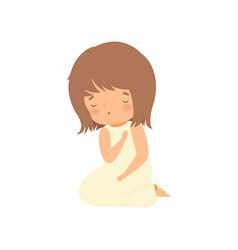 Adorable little girl character praying standing on vector