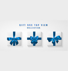 set white gift box with blue bow and ribbon top vector image