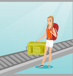 Woman picking up suitcase from conveyor belt vector