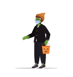 guy in mask wearing zombie costume holding bucket vector image