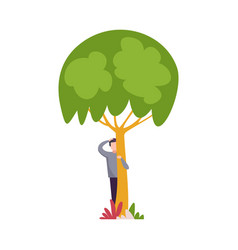 Young man standing behind green tree scratching vector