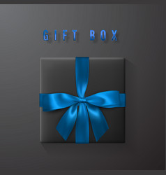 Black gift box with blue bow and ribbon top view vector
