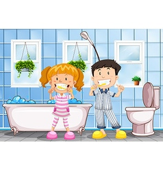 Boy and girl brushing teeth in the bathroom vector