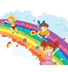 kids on rainbow vector image