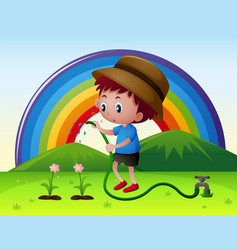 boy watering flowers in garden vector image