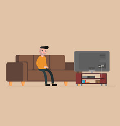 Man sitting on the couch and playing console vector