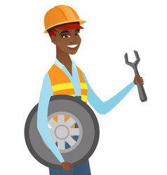 Young african mechanic with tyre and spanner vector