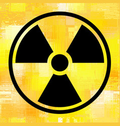 Sign radiation on grunge yellow background vector
