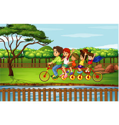 family riding bike in park vector image