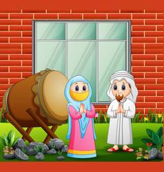 Happy muslim couples congratulate eid mubarak vector