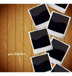 Photo frames on wooden texture vector image vector image