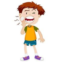 Little boy having toothache vector