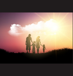 silhouette of a family walking against a sunset vector image