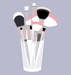 With glass and makeup brushes vector