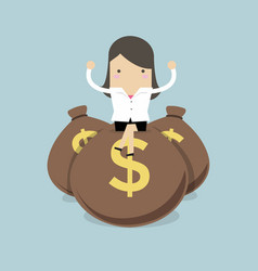 businesswoman sitting on top of a pile of dollar vector image