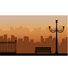 Silhouette of street lamp with urban background vector