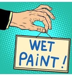 Hand holding a sign wet paint vector image