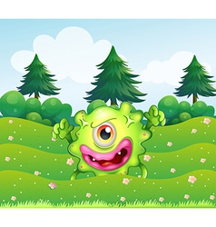 A hilltop with a playful monster vector