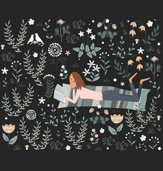 Girl reading a book lying on mat at meadow vector