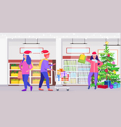people in santa hats buying groceries christmas vector image