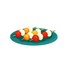 Canape with cheese balls and berries on wooden vector