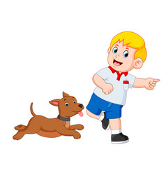 Boy playing with his dog vector