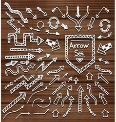 hand drawn arrows on wooden texture vector image