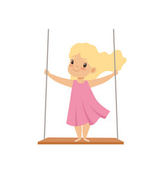 Lovely blonde girl swinging on a rope swing vector
