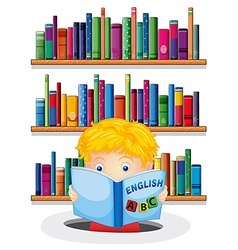 A boy in the library reading an English book vector image