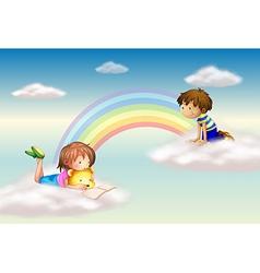 A rainbow with kids vector