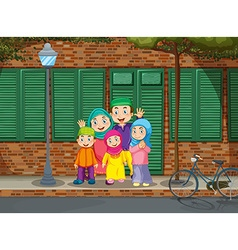Muslim family standing by the road vector