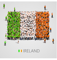 large group of people in the ireland flag shape vector image vector image