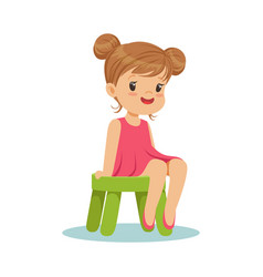 Beautiful little girl sitting on a small green vector