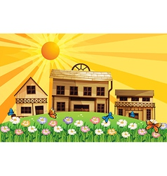 A garden at the hills near the wooden houses vector