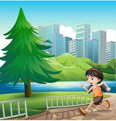 A young girl running at the riverbank vector image vector image