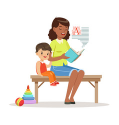 teacher reading a book to little boy while sitting vector image vector image