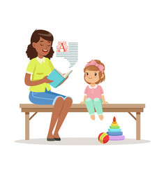 teacher reading a book to little girl sitting on a vector image