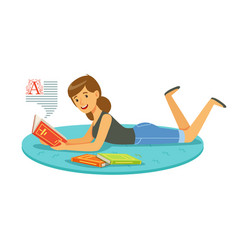 beautiful woman reading a book while lying on her vector image