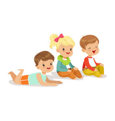 sweet little kids sitting and lying on the floor vector image vector image