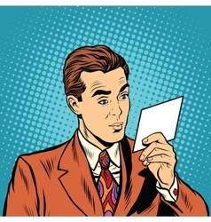 Retro pop art man reading an invitation vector image vector image