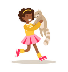 happy girl holding a gray cat on her hands vector image